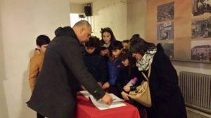 AIS signing guest register at Bunk'Art